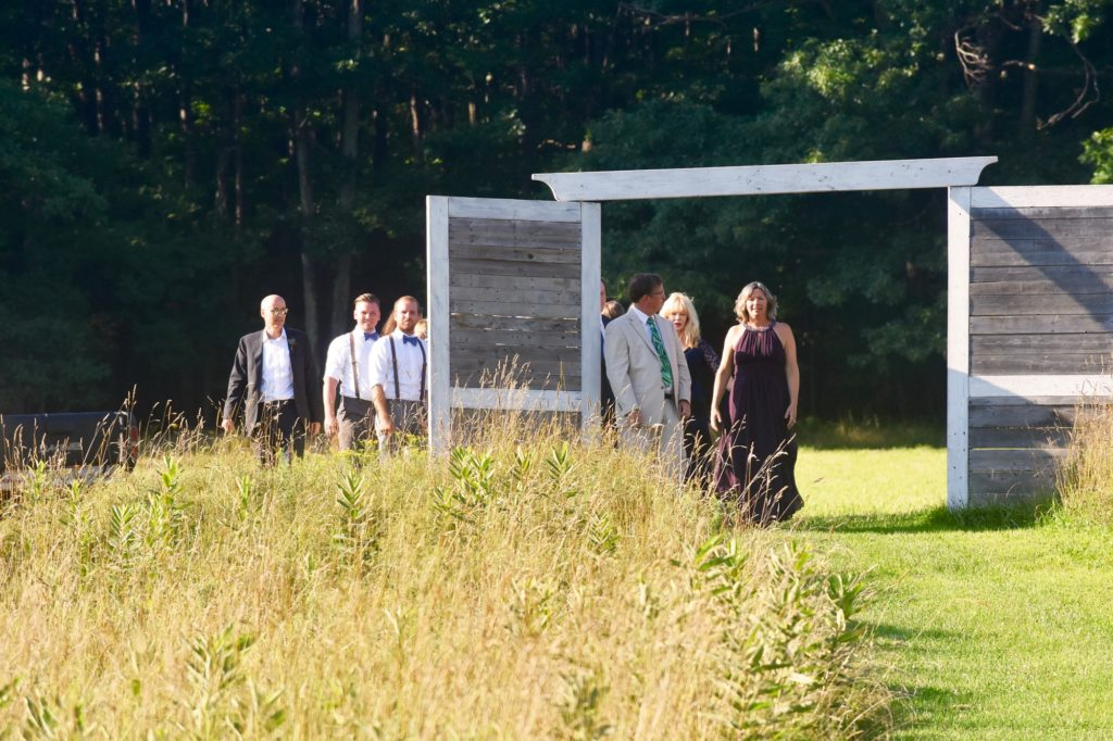 Cute doorway in the field to frame the procession